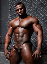 Ebony bodybuilder Aden Taylor stokes his muscled cock