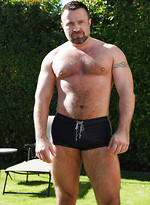 Horny bear Marc Angelo shows his cock outdoors