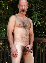 Evan Scott: bear gets naked in a garden