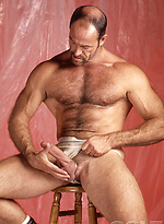Muscle man Tony Mills jerking off dick