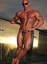Athlete Peter Latz posing naked on a balcony